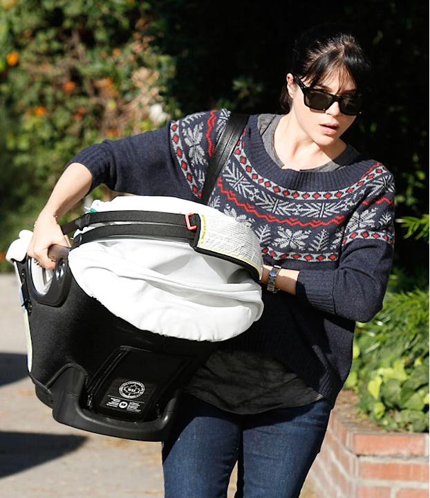 Celebrities wearing Christmas jumpers: Selma Blair choose to rock her red and navy knit with superstar shades, we're not sure we'll try this look though.