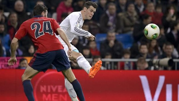Real Madrid's Welsh star Gareth Bale (R) vies with Osasuna's defender Damia Abella during the Spanish Copa del Rey (King's Cup) football match Real Madrid CF vs CA Osasuna at the Santiago Bernabeu AFP