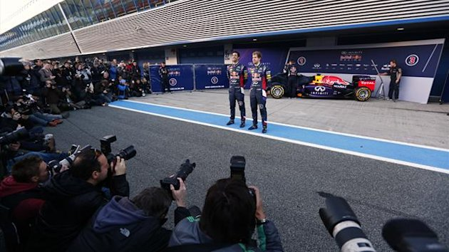 Red Bull Formula One drivers Sebastian Vettel (R) of Germany and Daniel Ricciardo of Australia pose in front of the new RB10 during the official presentation of the Red Bull Formula One Team 2014 at the Jerez racetrack in southern Spain January 28, 2014