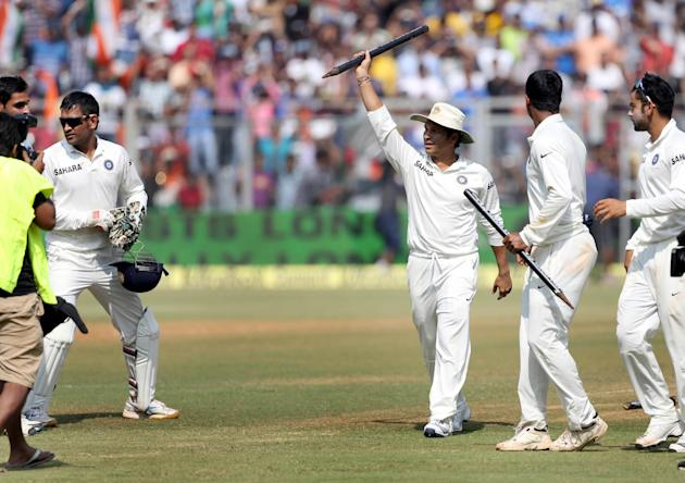 Cricket legend Sachin Tendulkar and other Indian cricketers celebrate after winning the Test match series against West Indies on the third day of the second Test to give a fitting farewell to Tendulka