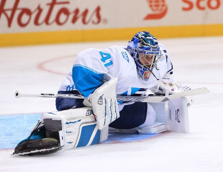 Jaroslav Halak of Team Europe stretches between plays against Team Canada (Getty Images)
