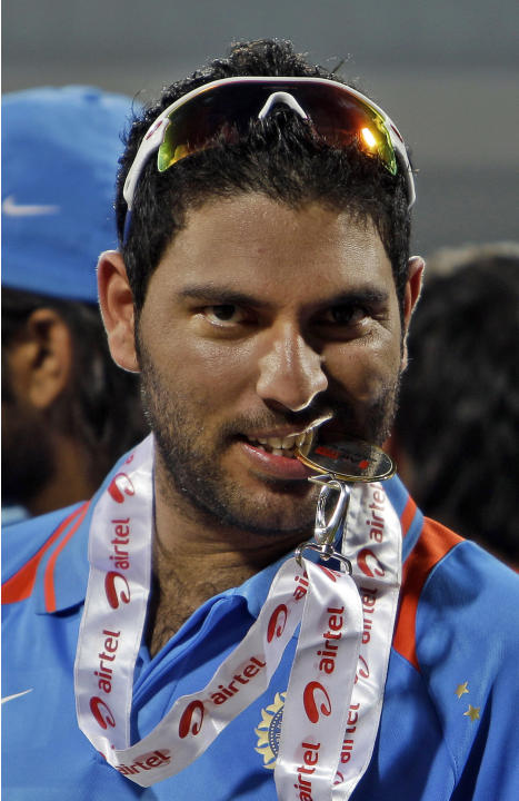 Indian cricketer Yuvraj Singh bites his Man of the Match medal after his team's win over New Zealand in the last one day international cricket match in Chennai, India, Friday, Dec. 10, 2010. India won