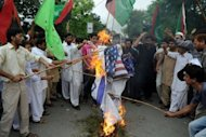 Pakistani Muslims protesters torch US and Israeli flags as they attempt to reach the US embassy during a demonstration in Islamabad. Anti-US protests by crowds whipped into fury by a film that ridicules Islam's Prophet Mohammed erupted across the Arab world on Friday, leading to an explosion of violence in Sudan, Yemen and Lebanon