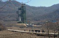 This file photo shows North Korean officials and foreign journalists leaving the launch pad after a visit to see the rocket Unha-3 in Tangachai-ri space center on April 8. S.Korea is seeking to extend United Nations sanctions to 19 more N.Korean institutions following the country's widely condemned rocket launch this month, according to a report