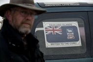 A resident stands next to a sign on a car in the Falkland Islands. Britain and Argentina will on Monday mark 30 years since the invasion of the Falkland Islands triggered a 74-day war, the fallout from which has sparked a fresh diplomatic clash