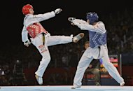 Turkey's Servet Tazegul (blue) fights against Iran's Mohammad Bagheri Motamed during their men's taekwondo gold medal bout in the under 68 kg category as part of the London 2012 Olympic games, on August 9, 2012 at the ExCel centre in London. AFP PHOTO / ALBERTO PIZZOLI