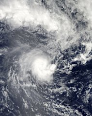 Tropical Cyclone Evan is captured in this NASA's Aqua satellite image, on December 13, 2012. Fijians living in low-lying areas have been urged to flee to higher ground as Evan bores down on the South Pacific nation after leaving a trail of destruction in Samoa with up to 10 feared dead