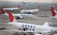Japan Airlines passenger jets at Tokyo International Airport at Haneda in 2010. A Japan Airlines flight to the US with over 250 passengers and crew on board was aborted due to a bomb threat which reportedly demanded the release of a notorious criminal, the airline said Thursday