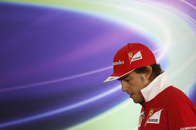 Ferrari Formula One driver Fernando Alonso of Spain attends a news conference ahead of the Chinese F1 Grand Prix at the Shanghai International Circuit