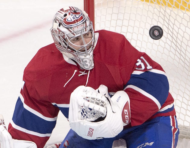 Montreal Canadiens goalie Carey Price keeps his eyes on the puck during the third period of the team's NHL hockey game against the Vancouver Canucks on Wednesday, Nov. 2, 2016, in Montreal. (Ryan Remiorz/The Canadian Press via AP)