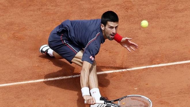 TOPSHOTS Serbia's Novak Djokovic Hits A Return To Spain's Rafael Nadal  AFP/Getty Images