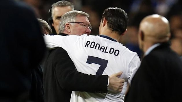 Sir Alex Ferguson embraces Cristiano Ronaldo (Reuters)