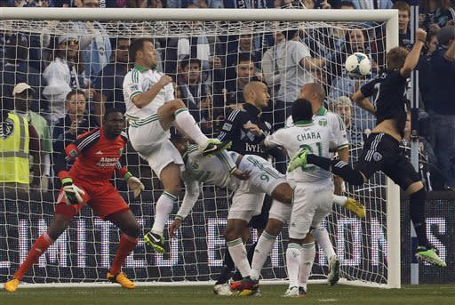 Wallace lifts Timbers past Sporting KC, 3-2