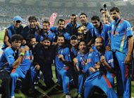 Indian cricketers celebrate with the trophy following their victory against Sri Lanka in the ICC Cricket World Cup final at Wankhede Stadium in Mumbai, in 2011. India's cricketers have been ordered to wear the same jersey design for next week's World Twenty20 in a bid to bring them good luck