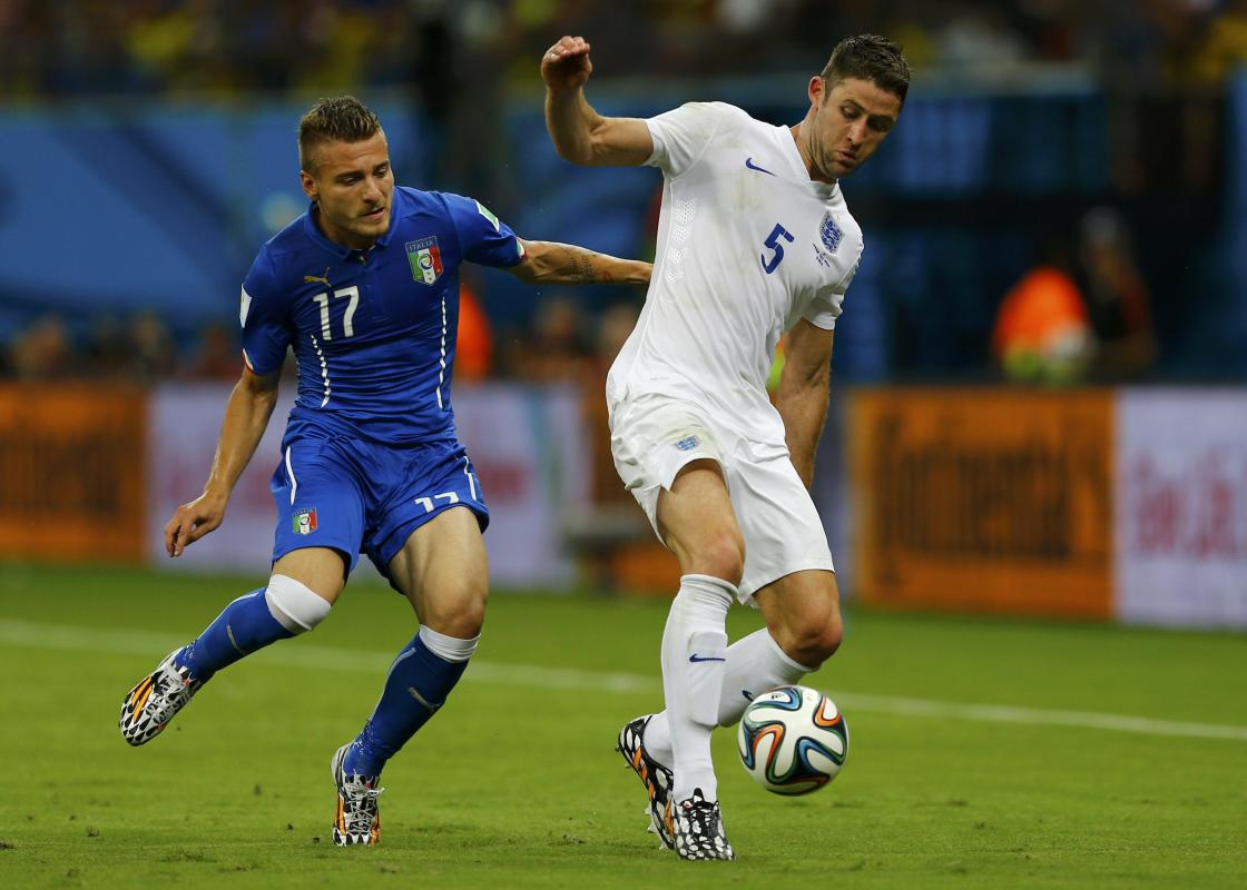 Italy's Immobile fights for the ball with England's Cahill during their 2014 World Cup Group D soccer match at the Amazonia arena in Manaus