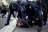 "A pro-gay marriage militant is arrested by riot police during a demonstration by supporters of the anti-gay marriage movement ""La Manif Pour Tous"" (Demonstration for all!) on April 18, 2013 in Nantes, western France. President Francois Hollande hit out at ""homophobic"" acts by opponents of a same-sex marriage bill following violent protests that included an attack on a gay bar"