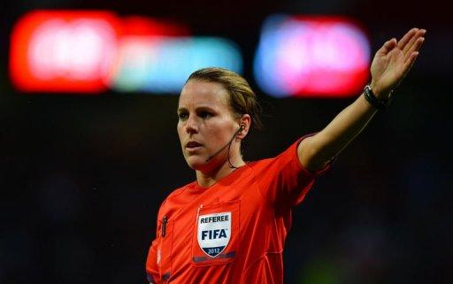 Referee Christina Pedersen of Norway officiates