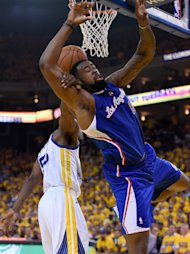 OAKLAND, CA - APRIL 24: Deandre Jordan #6 of the Los Angeles Clippers is fouled by Jordan Crawford #55 of the Golden State Warriors in Game Three of the Western Conference Quarterfinals during the 2014 NBA Playoffs at Oracle Arena on April 24, 2014 in Oakland, California. NOTE TO USER: User expressly acknowledges and agrees that, by downloading and or using this photograph, User is consenting to the terms and conditions of the Getty Images License Agreement. (Photo by Thearon W. Henderson/Getty Images)