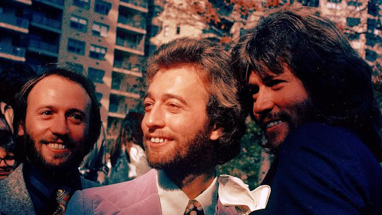 FILE- In this undated file photo, from left, members of The Bee Gees Musical Group, Maurice Gibb, Robin Gibb, Barry Gibb pose for a photo. A representative said on Sunday, May 20, 2012, that  Robin Gibb died at the age of 62. (AP Photo)