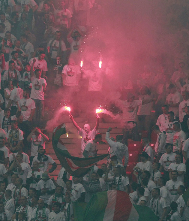 Polish fans hold flares during the final match of the Poland Cup between Legia Warszawa and Lech Poznan at National Stadium in Warsaw, Poland, Saturday, May 2, 2015.(AP Photo/Czarek Sokolowski)