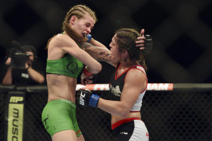 Bethe Correia (right) lands a head shot on Jessamyn Duke during UFC 172. (USA TODAY Sports)