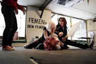 Activists of the Ukrainian feminist movement Femen take part in a training session at the official Femen Centre, in Paris, on January 19, 2013. The Paris office is run by Inna Shevchenko, who claimed asylum in France in 2012, fearing persecution after she sawed down a large wooden cross that stood in the centre of Kiev