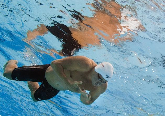In a picture taken with an underwater camera US swimmer Ryan Lochte competes in the heats of the men's 200-meter individual medley swimming event in the FINA World Championships at the indoor stadium