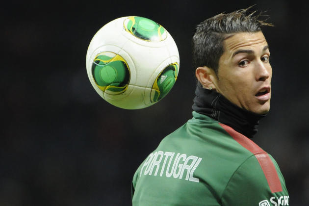 Portugal's Cristiano Ronaldo warms up before World Cup qualifier against Sweden, in Stockholm