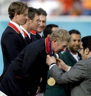 Nick Skelton, of Great Britain, receives his gold medal after Great Britain won the equestrian team show jumping at the 2012 Summer Olympics, Monday,