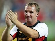 Liverpool FC's manager Brendan Rodgers acknowledges the crowd following the Herbalife World Football Challenge in Toronto, Ontario, in July 2012. Rodgers is confident his side's potentially explosive clash against Manchester United on Sunday will pass off peacefully