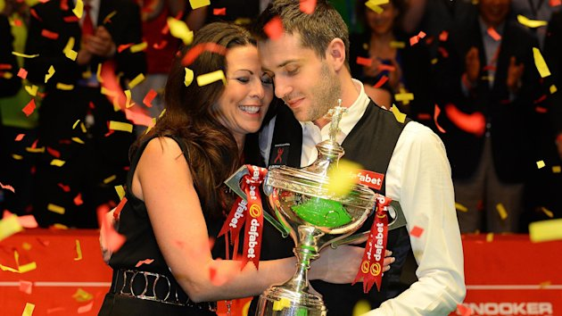 Mark Selby with wife Vikki and the world title (AFP).