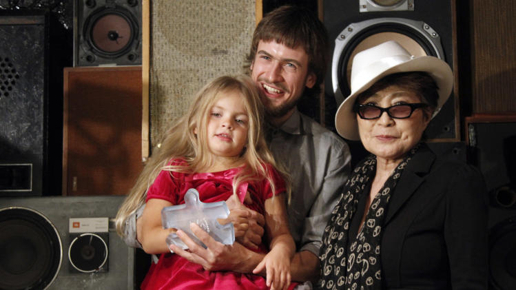 Yoko Ono, right, and Pussy Riot member Nadia Tolokonnikova's husband Pyotr Verzilov and daughter Gera pose for photographers after Ono presented Verzilov the LennonOno Grant for Peace  Friday, Sept. 21, 2012 in New York.  (AP Photo/Mary Altaffer)