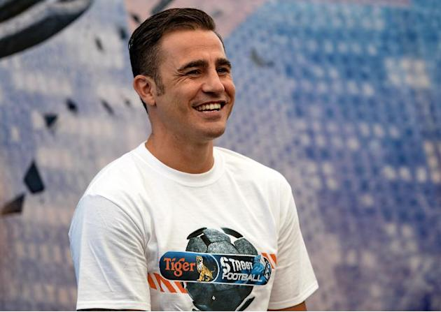 World Cup-winning captain Fabio Cannavaro attends a promotional event for Tiger Street Football in Singapore on October 17, 2013