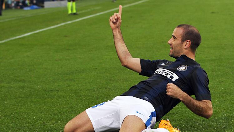 Inter Milan's Rodrigo Palacio celebrates after scoring during the Serie A soccer match between Udinese and Inter, at the Friuli Stadium in Udine, Italy, Sunday, Nov. 3, 2013