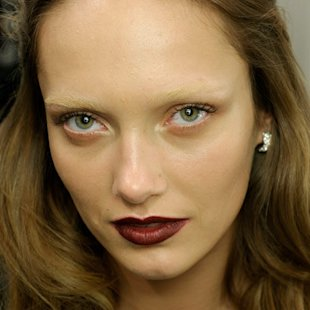 Model at Gucci AW12 backstage wearing berry lips