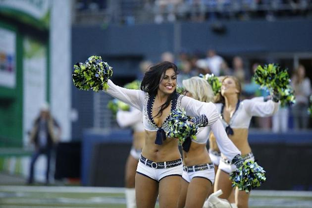 Seattle Seahawks Sea Gals cheerleaders perform during an NFL football game against the Green Bay Packers, Thursday, Sept. 4, 2014, in Seattle. (AP Photo/Elaine Thompson)