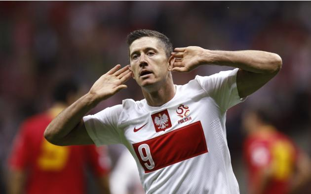 Poland's Lewandowski gestures as he celebrates scoring a goal against Montenegro during their 2014 World Cup qualifying soccer match in Warsaw