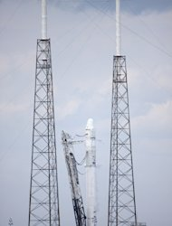 The SpaceX Falcon 9 rocket remains standing on Launch Complex 40 at Cape Canaveral Air Force Station in Florida following a test firing of the vehicle's nine Merlin first-stage engines. Image released Feb. 25, 2013.