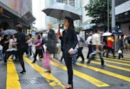 French expatriate Annie Pudlo stands on a street in Hong Kong's Central district. The number of French expatriates in the East have been growing faster than anywhere else: 11% last year including 22% in Indonesia and 11.4% in China, according to French government figures