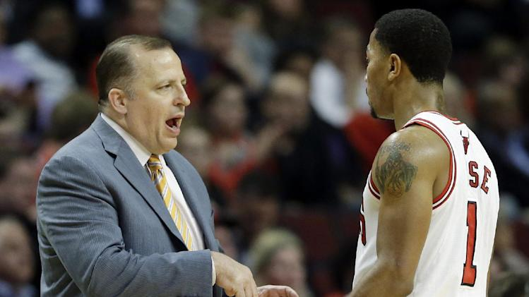 Chicago Bulls head coach Tom Thibodeau, left, talks with guard Derrick Rose during the first half of an NBA preseason basketball game against the Detroit Pistons in Chicago on Wednesday, Oct. 16, 2013