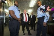 "Toronto Mayor Rob Ford (2nd L) walks between two security guards and in front of his brother and city councillor Doug Ford (2nd R) to respond to the Toronto police investigation dubbed ""Project Brazen 2"" to the media at City Hall in Toronto, October 31, 2013. REUTERS/Mark Blinch"