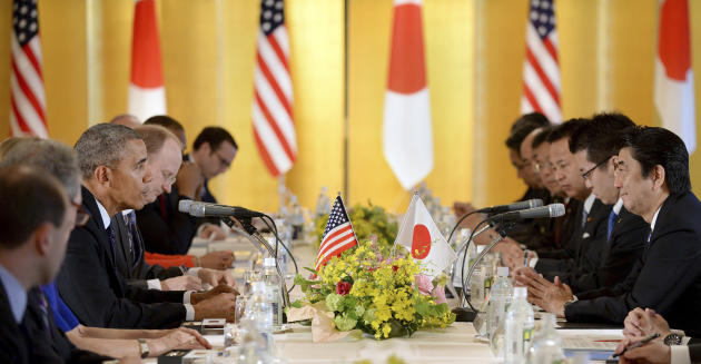 U.S. President Barack Obama, fourth left, speaks to Japanese Prime Minister Shinzo Abe, right, during their talks at the Akasaka State Guest House in Tokyo, Thursday, April 24, 2014. Facing fresh ques