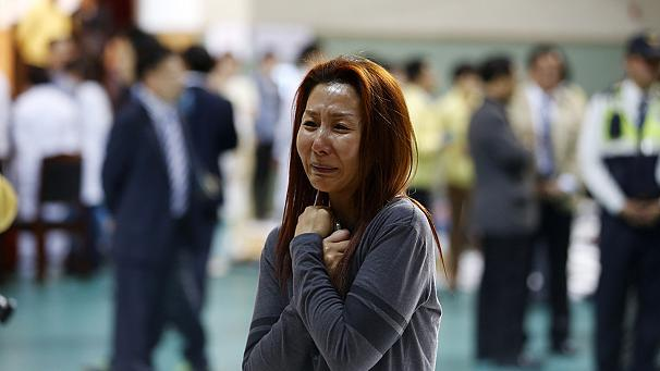 Anxious parents wait for news of children on board sunken South Korea ferry