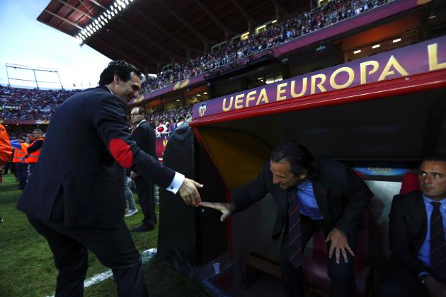 Sevilla's coach Unai Emery and Valencia's coach Juan Antonio Pizzi greet before the start of their Europa League semi-final first leg soccer match in Seville