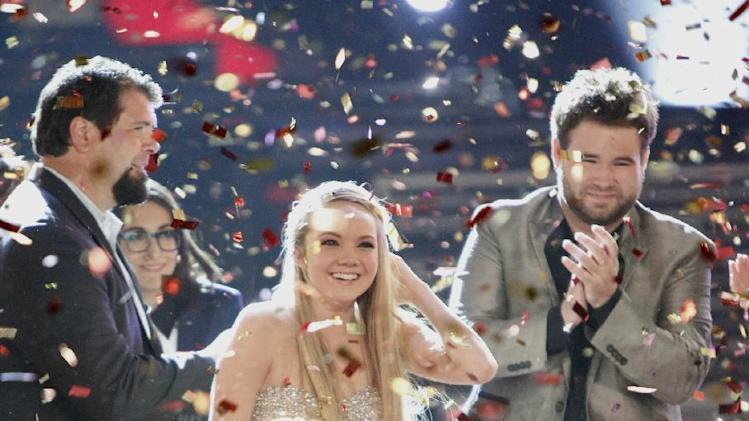 "In this image provided by NBC confetti falls on Danielle Bradbery after she won season-four of ""The Voice"" Tuesday June 18, 2013. (AP Photo?NBC, Tyler Golden)"