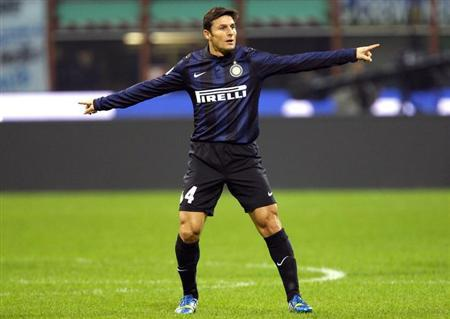 Inter Milan's Javier Zanetti gestures during their Italian Serie A soccer match against Livorno at the San Siro stadium in Milan November 9, 2013. REUTERS/Alessandro Garofalo