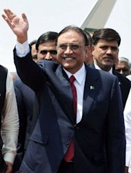 In this handout photograph released by the Indian Press Information Bureau (PIB), Pakistani President Asif Ali Zardari waves after his arrival at Palam Air Base on the outskirts of New Delhi. Zardari became the first Pakistani head of state since 2005 to visit South Asian neighbour India for a one-day trip aimed at building goodwill between the nuclear-armed rivals