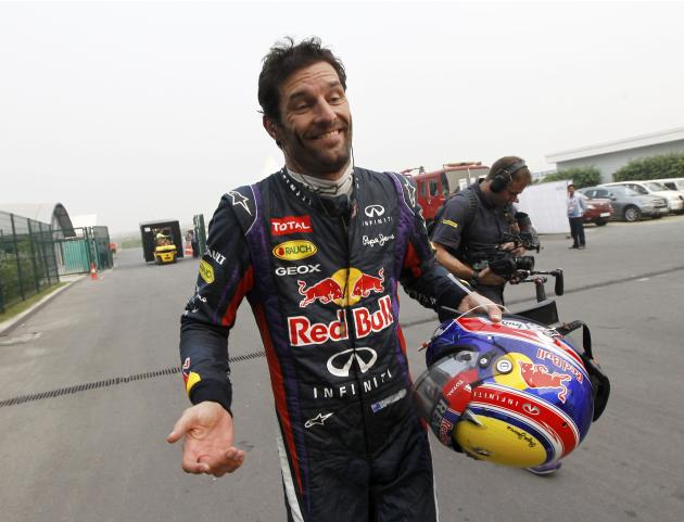 Red Bull Formula One driver Webber reacts as he returns to the garage area after he retired from the race during the Indian F1 Grand Prix at the Buddh International Circuit in Greater Noida