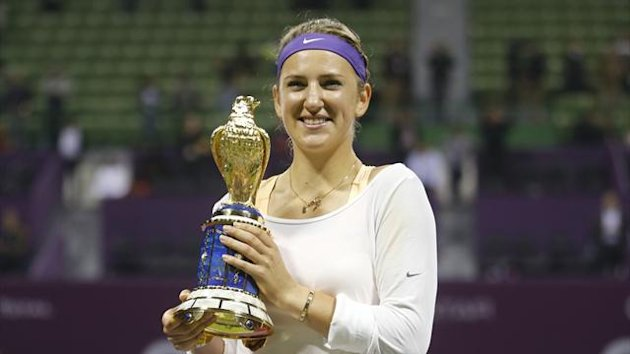 Victoria Azarenka of Belarus holds her trophy after defeating Serena Williams of the U.S. during the final match at the Qatar Open tennis tournament in Doha February 17, 2013. (Reuters)