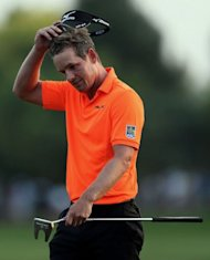English golfer Luke Donald during the third ound of the DP World Tour Championship in the Gulf emirate of Dubai. It will be a head-to-head clash between the world's top two golfers after Rory McIlroy and Donald opened up a three-shot lead at the top of the leaderboard